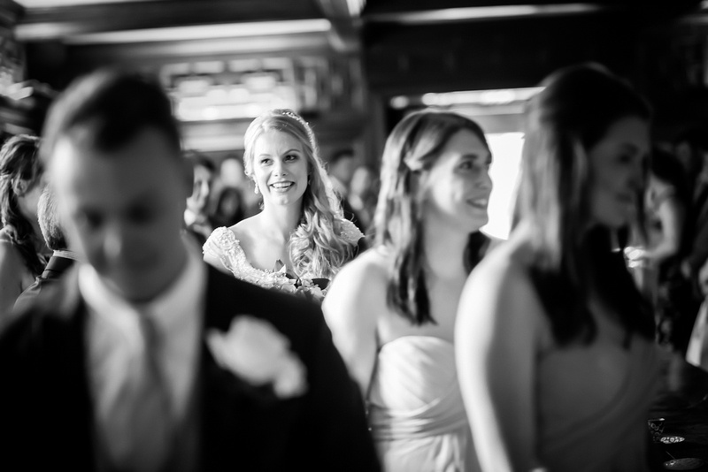 Black and white image of the bride walking down the aisle towards her groom at Bodrhyddan Hall.