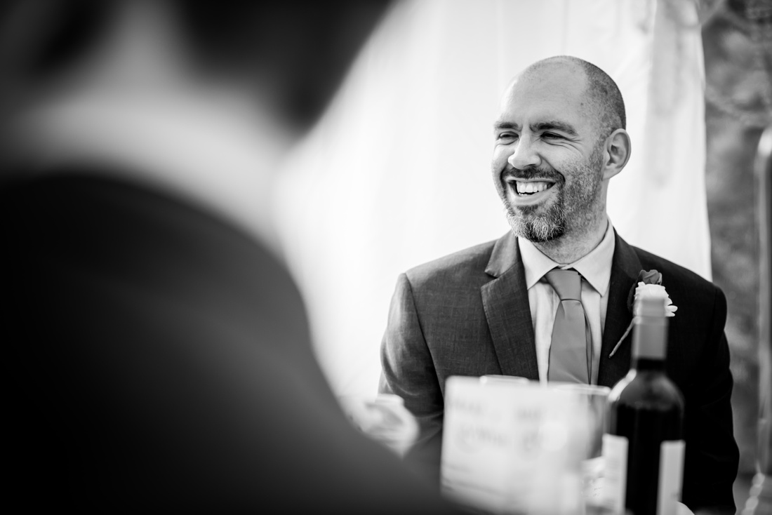 Black and white image of the groom during the wedding day at Soughton Hall.