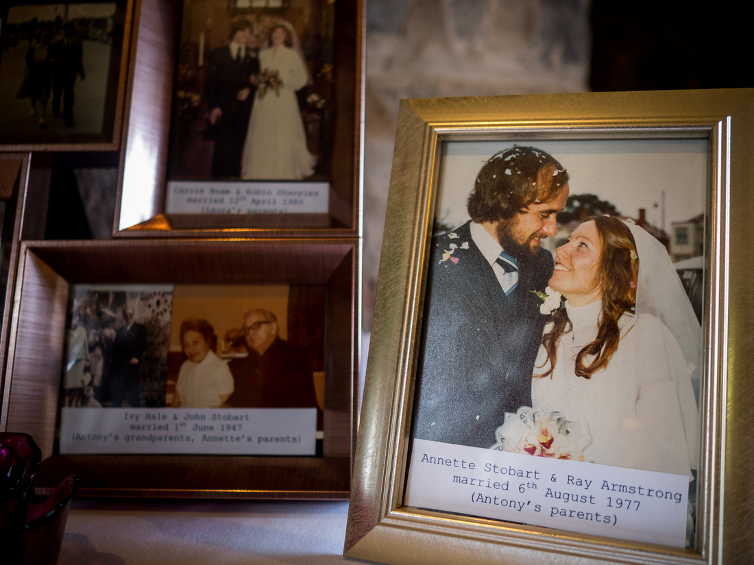 Image of framed photographs of bride and groom's parents and grandparents on their wedding days, from a wedding at Beeston Manor.