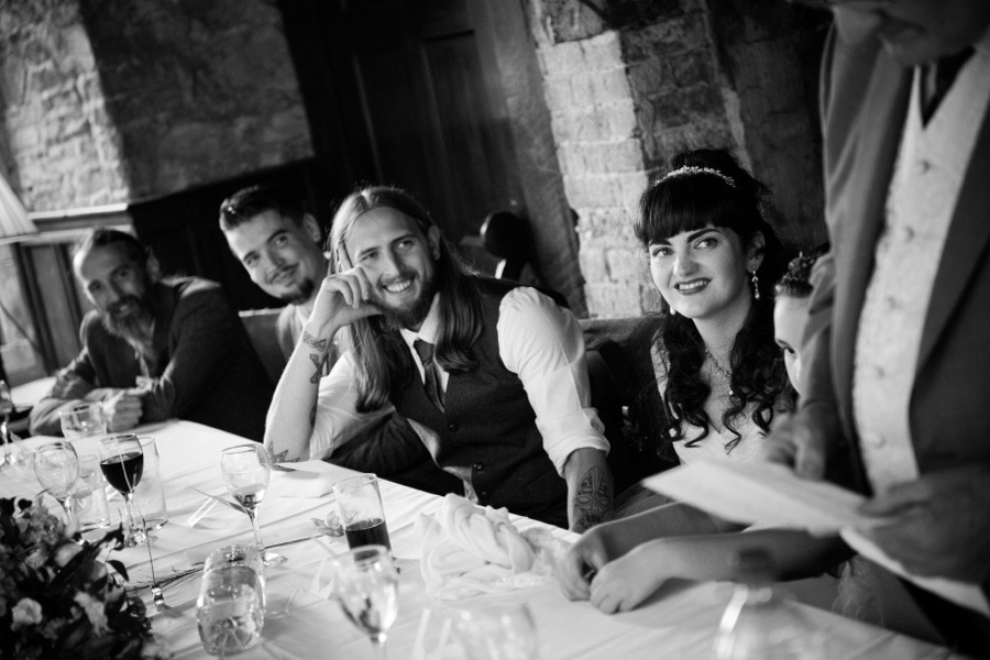Groom enjoying the speeches at his wedding  at Gwydir Castle, by Celynnen Photography, North Wales wedding photographer of the year