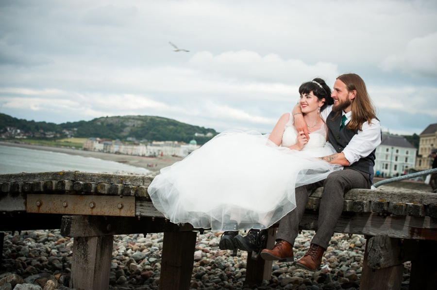 Bride and groom on their wedding day in llandudno by North Wales wedding photographer, Celynnen Photography