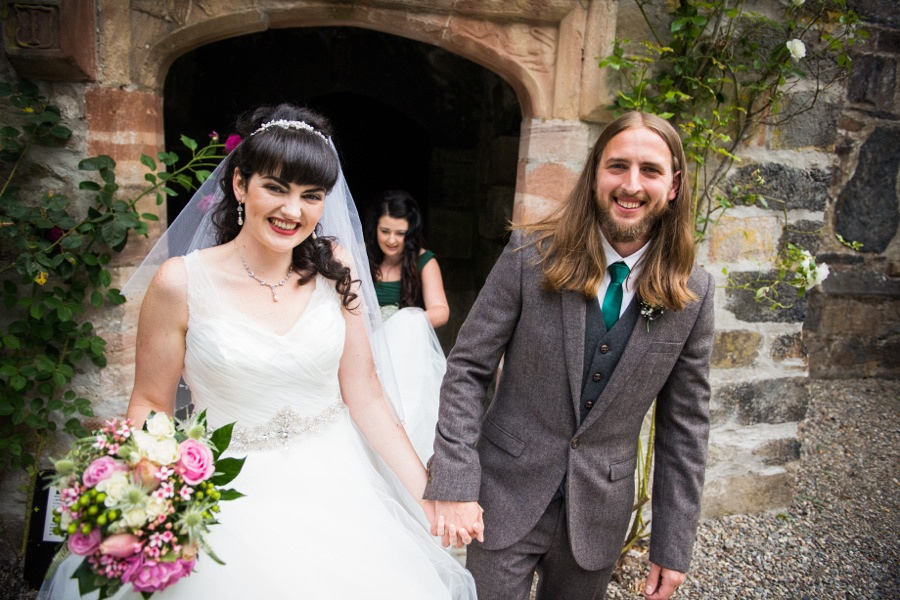 Bride and groom coming out of the wedding ceremony at Gwydir Castle. North Wales Wedding photographer, Celynnen Photography