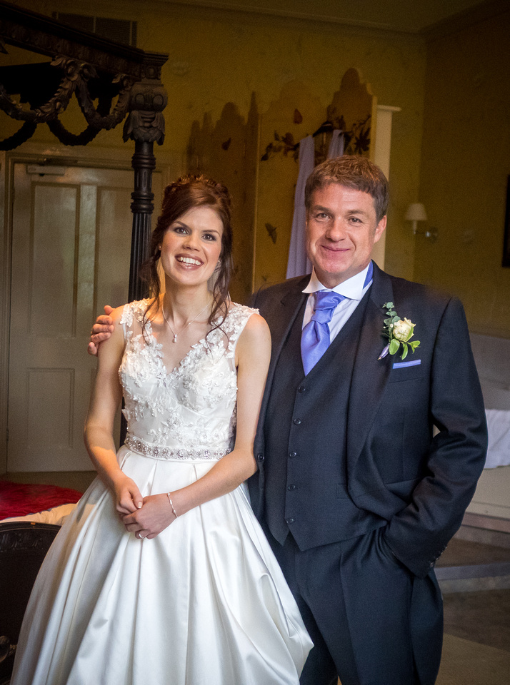 Portrait of the bride and her father before the wedding ceremony at Ruthin Castle.