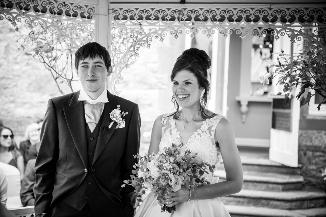 Black and white image of the bride and groom during their outdoor wedding ceremony at Ruthin Castle.