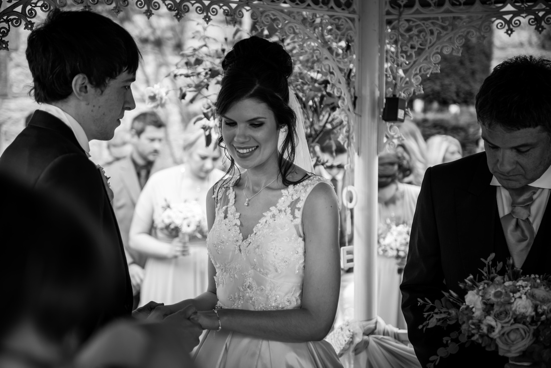 Black and white image of bride and groom during the wedding ceremony at Ruthin Castle.
