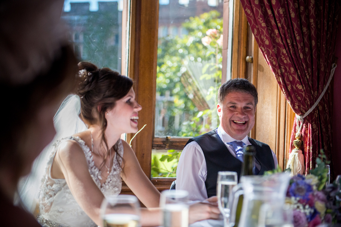 Image of the father of the bride enjoying the speeches at a wedding in Ruthin Castle.