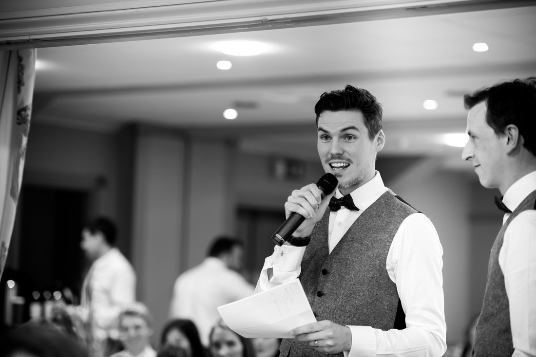 Speeches during a wedding at Lake Vyrnwy, featuring the bride, groom, best men and maid of honor