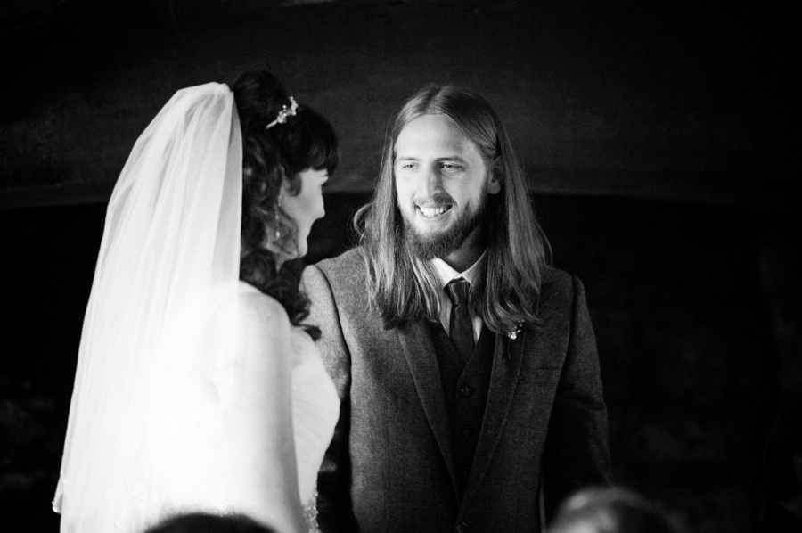Bride and groom looking at each other during their wedding at Gwydir Castle, Conwy. North Wales Wedding photographer, Celynnen Photography