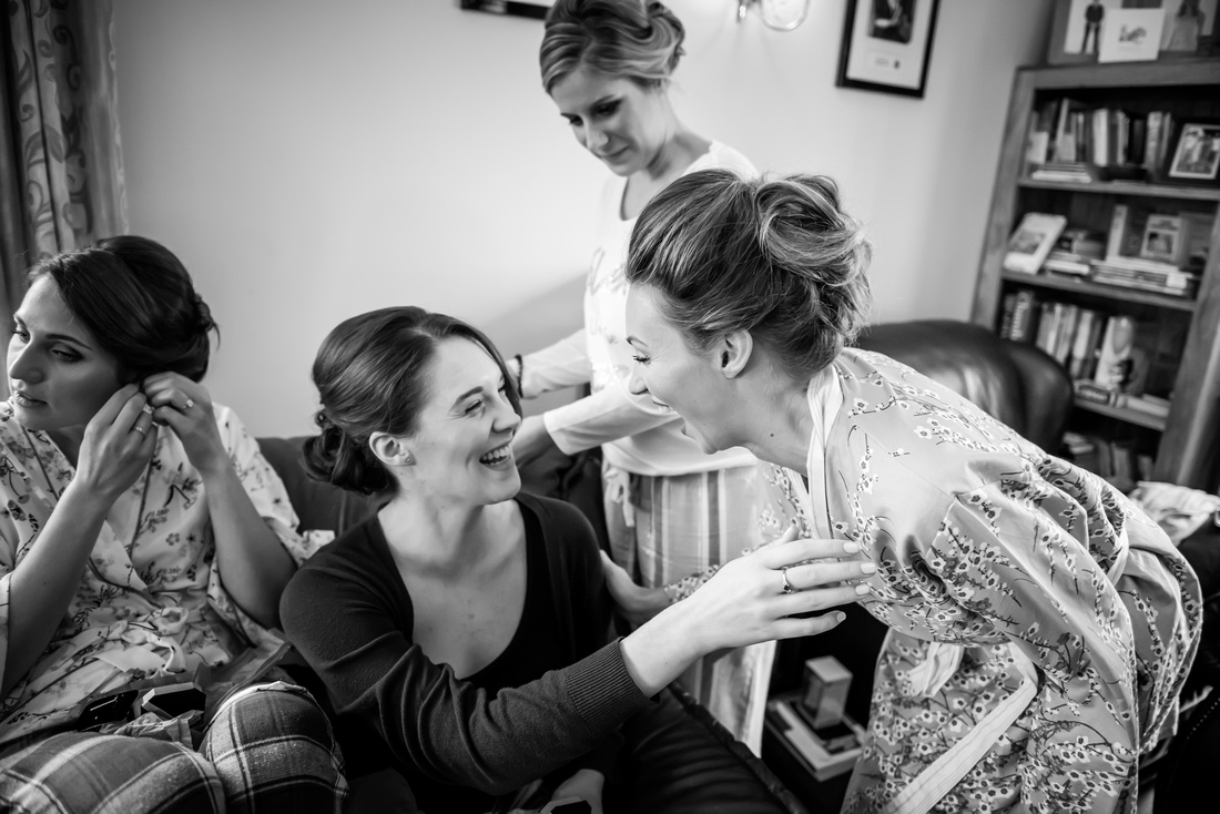 Roisin and her friends preparing for the wedding with a smile