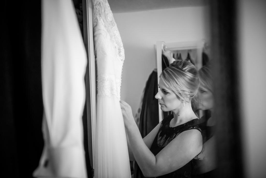 final inspection of the wedding dress for the bride