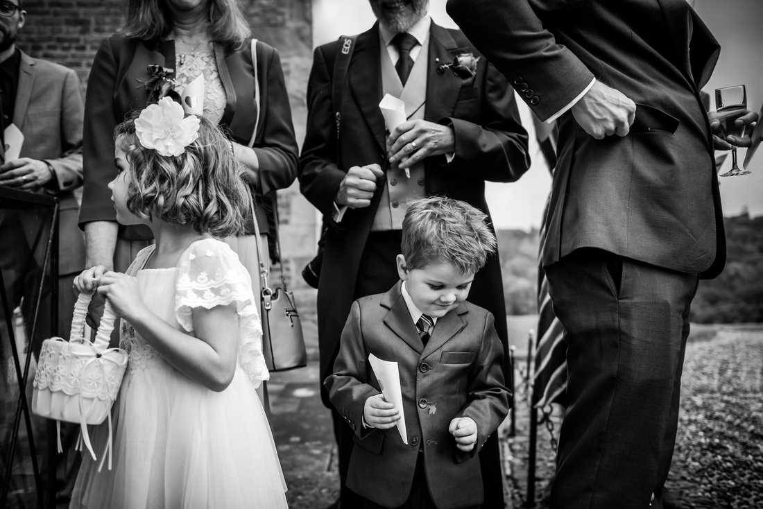 The flowergirl and the pageboy, waiting to throw confetti at a wedding at Brynkinalt Hall, Wrexham. Gold award print by North West Wedding Photographer of the Year, Celynnen Photography