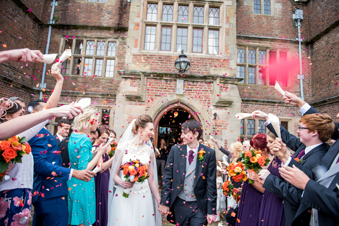 wedding confetti thrown during bride and groom's walk