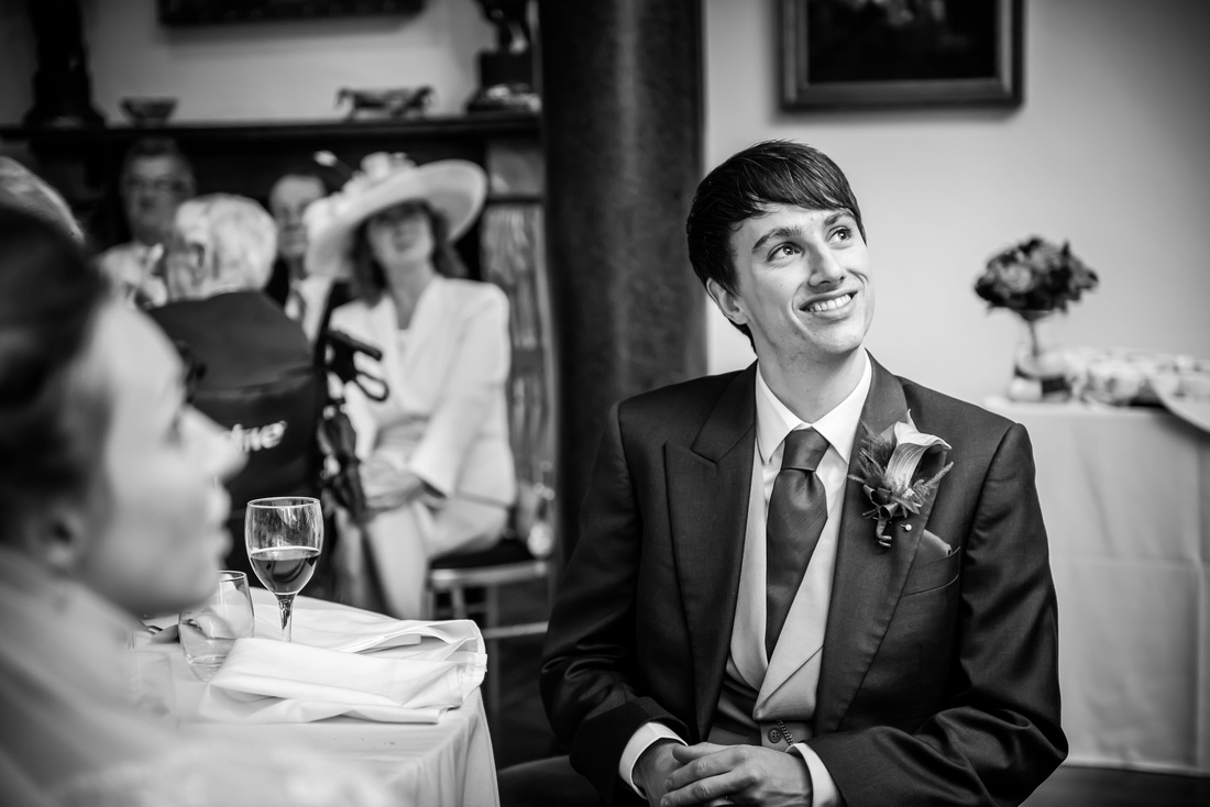 the smiling face of the groom