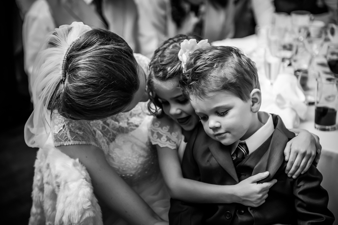 bride having fun with the little kids