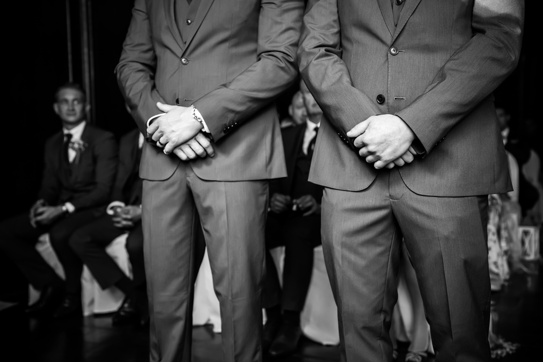 Black and white image of the groom and his best man waiting for the bride to walk down the aisle at a wedding in Portmeirion.
