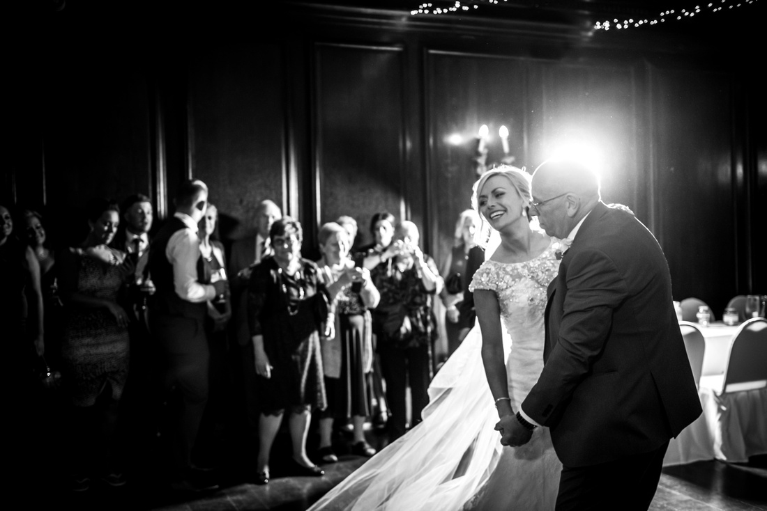 Bride dancing with her father on her wedding day at Portmeirion by North Wales wedding photographer Celynnen Photography