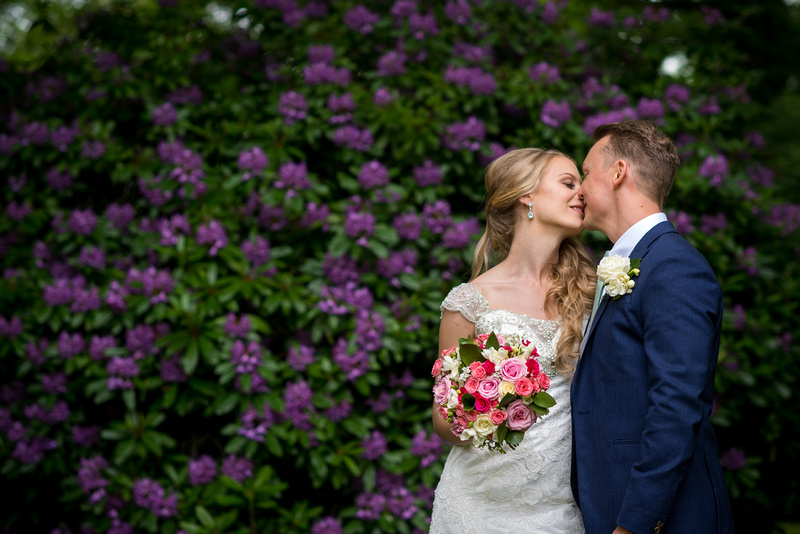 Image of the bride and groom about to kiss on their wedding day at Bodrhyddan Hall.