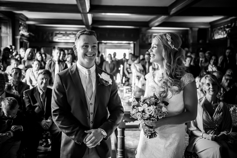 Black and white image of the bride and groom during their wedding ceremony at Bodrhyddan Hall.