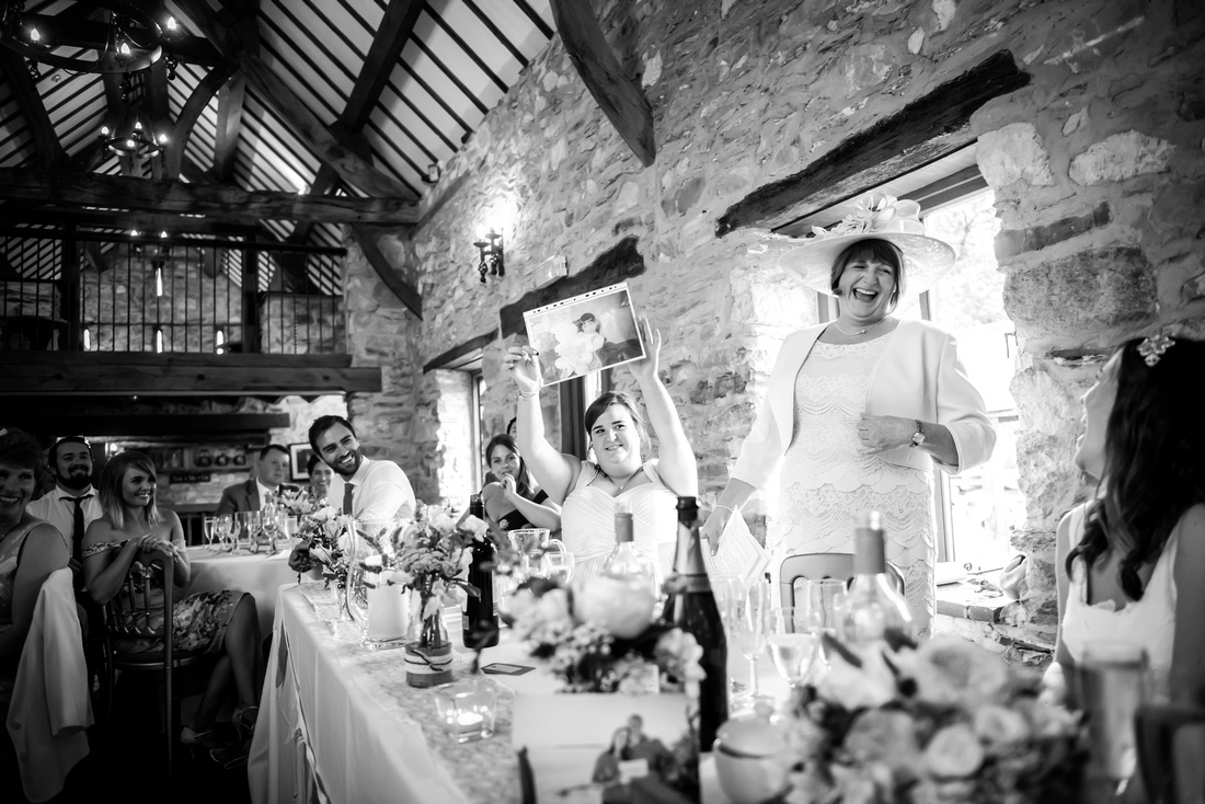 Black and white image of the mother of the bride giving her speech at a wedding at Plas Isaf.