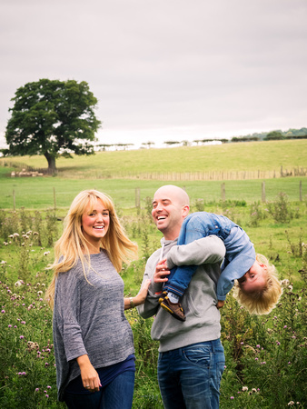 A happy family enjoying their family portrait shoot in north wales
