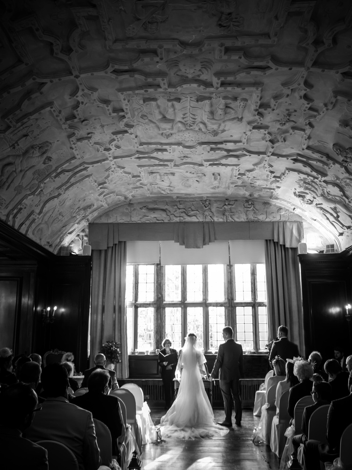 Black and white image of the ceremony room during a wedding in Portmeirion.