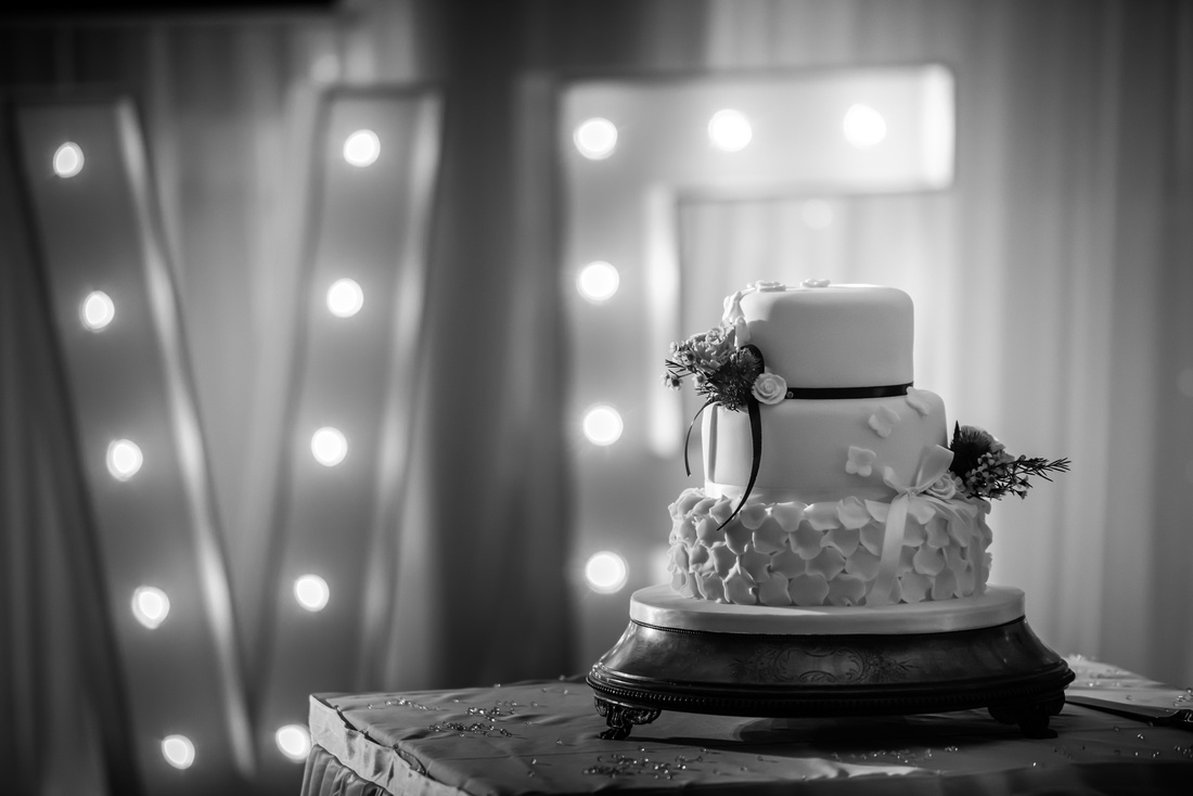 Black and white image of a wedding cake from a wedding at The Kinmel.