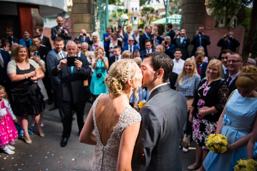 bride and groom kissing at their wedding in Portmeirion. Wedding photographer, Celynnen Photography