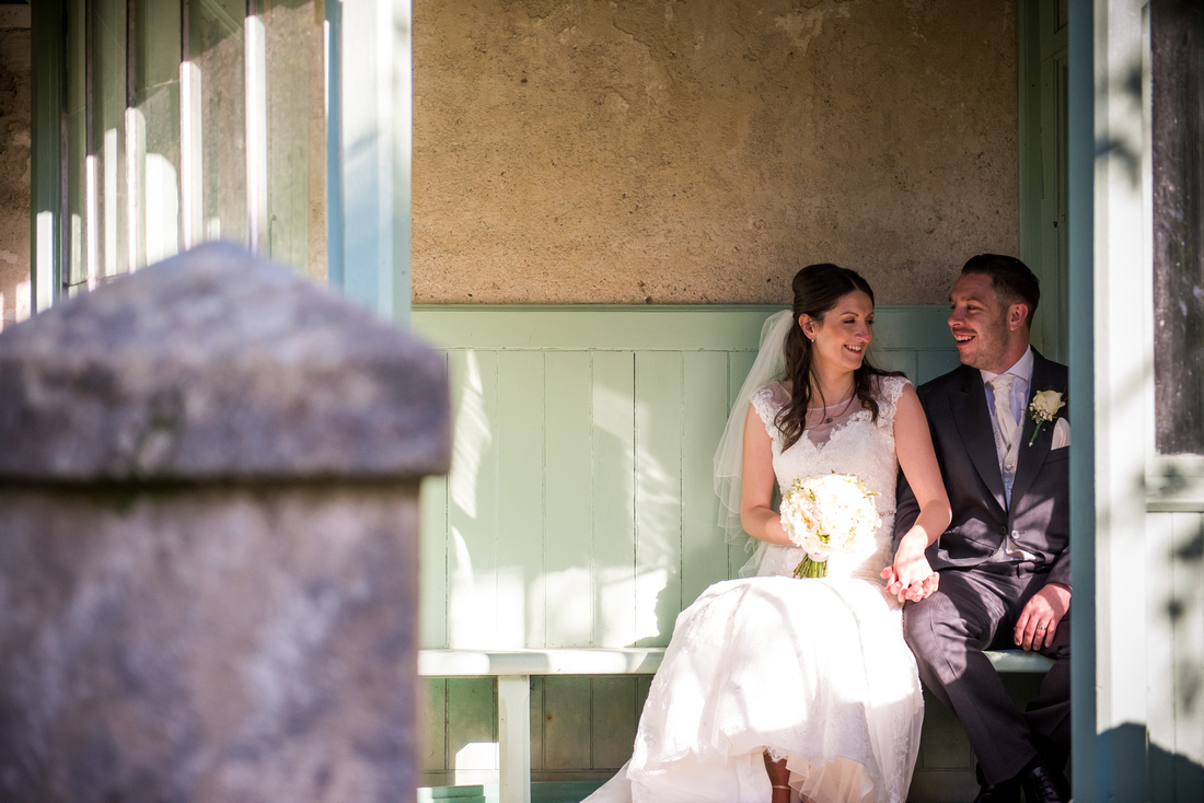 Photo of the bride and groom catching some alone time in the grounds of Chateau Rhianfa.