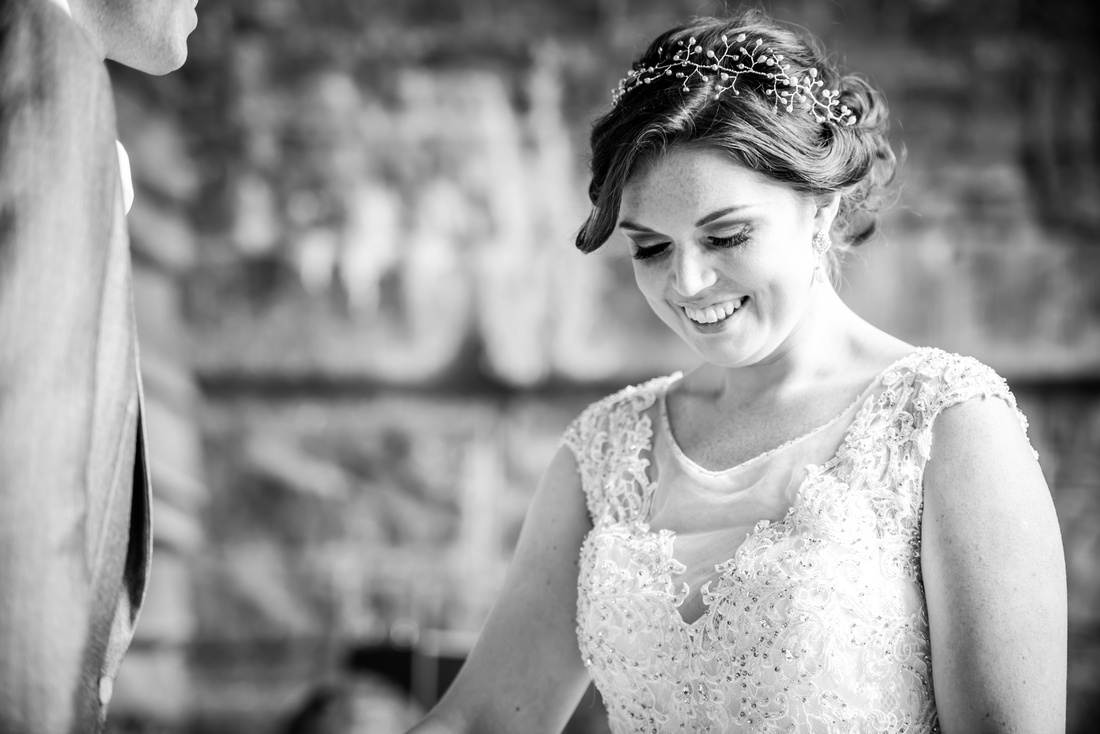 Black and white image of the bride during a wedding ceremony at Tower Hill Barns.