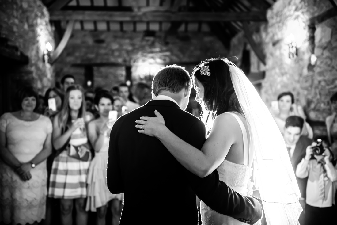 Black and white image of the bride and groom during their first dance. Location is Plas Isaf.