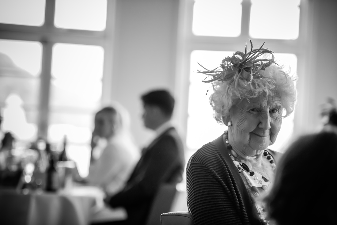 Black and white photograph of one of the guests at a wedding in Portmeirion.