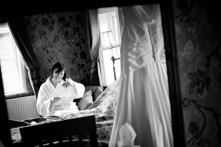Bride reading love not from her groom to be