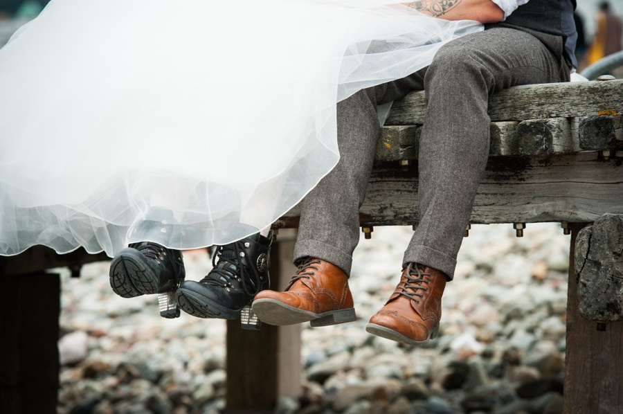 Bride and groom show off their shoes on their wedding day in llandudno by North Wales wedding photographer, Celynnen Photography
