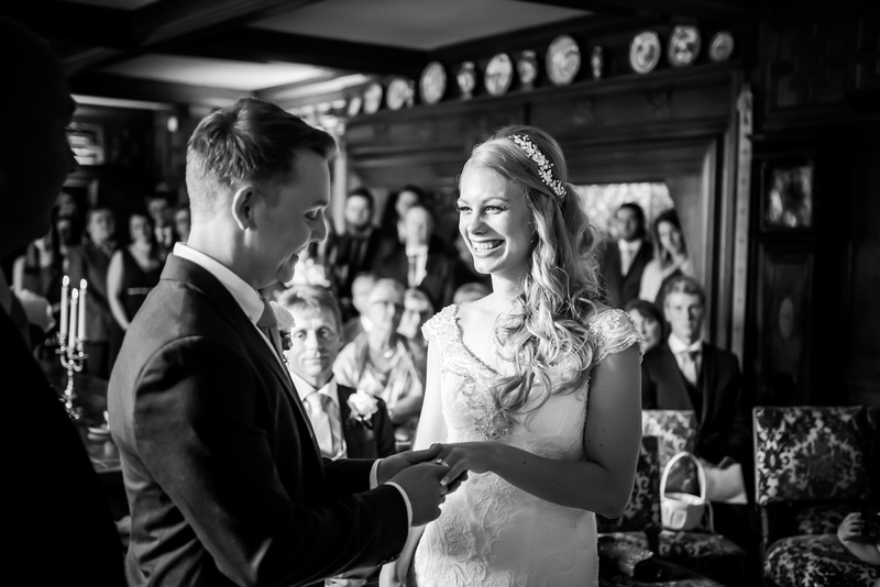 Black and white image of the bride and groom during their wedding ceremony.