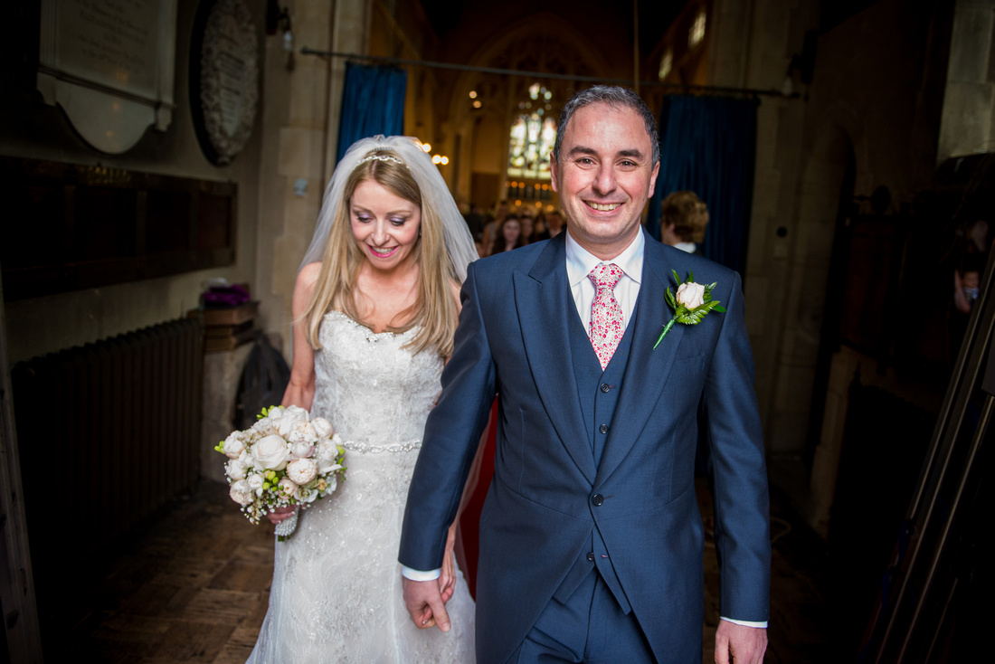 Bride and groom leaving their wedding ceremony as husband and wife in Buckinghamshire.