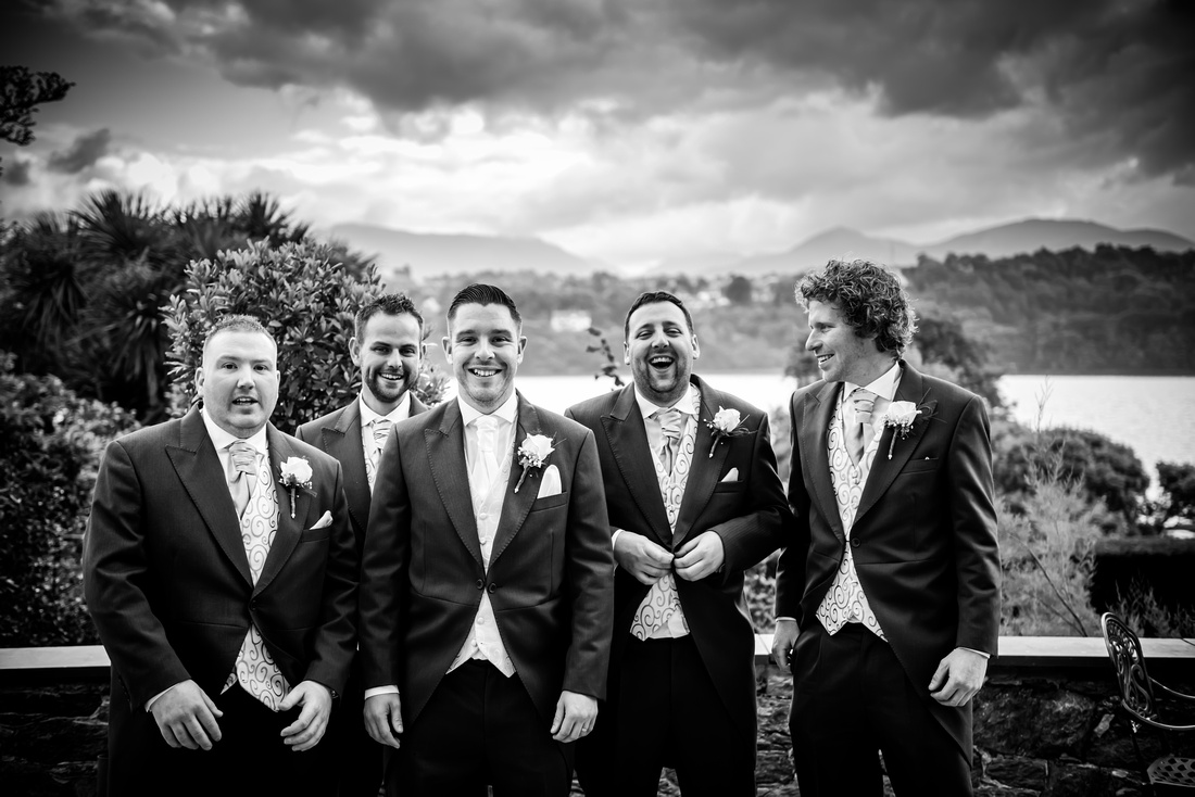 Black and white picture of the groom with his ushers at a wedding at Chateau Rhianfa.