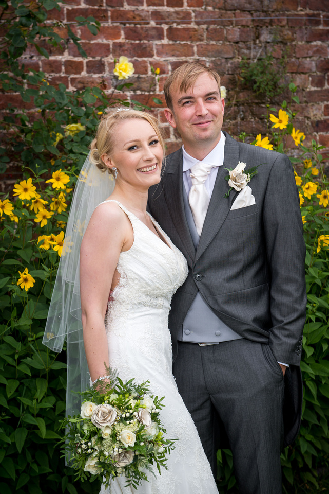 Portrait of a bride and groom on their wedding day at Pentre Mawr.