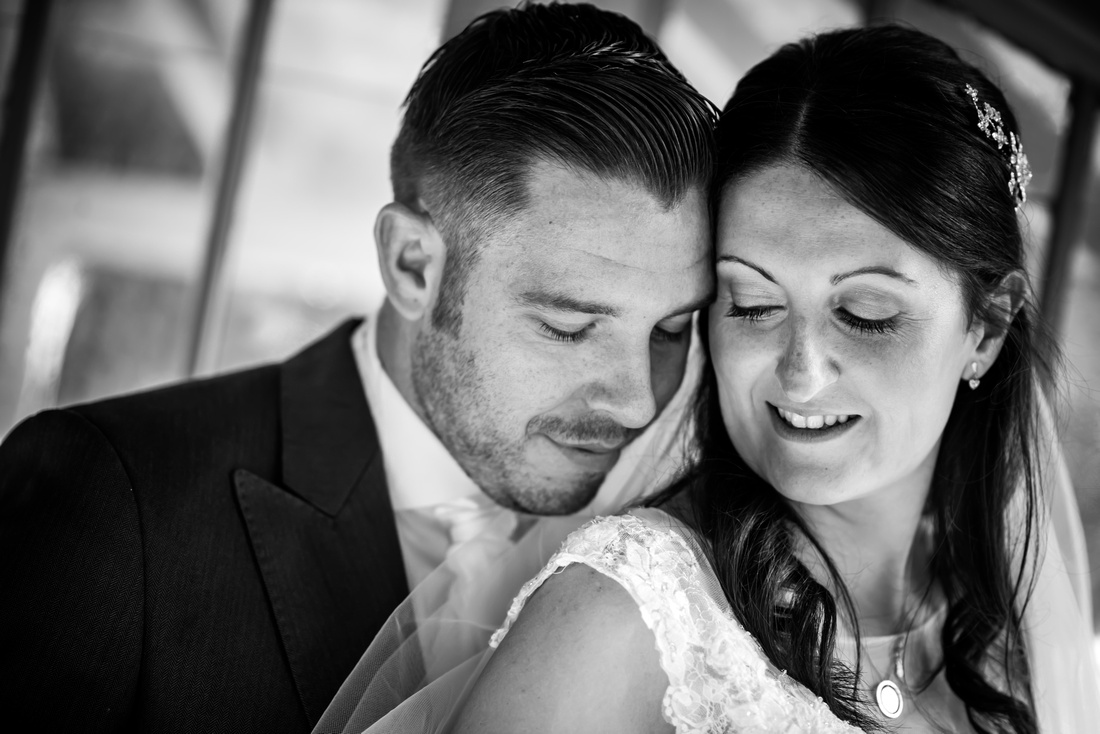 Black and white portrait of the bride and groom at their wedding at Chateau Rhianfa.