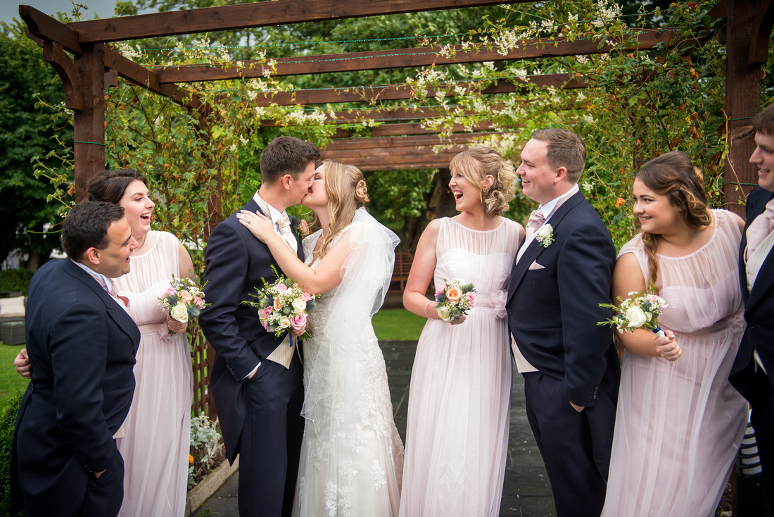 Outdoor portrait of bridal party from wedding at The Kinmel.
