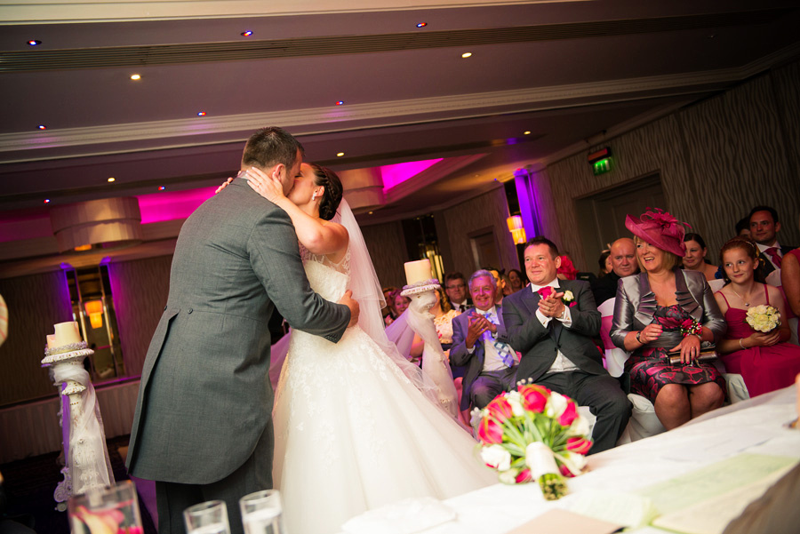 Photo of the bride and groom's first kiss as a married couple at their wedding at Grosvenor Pulford