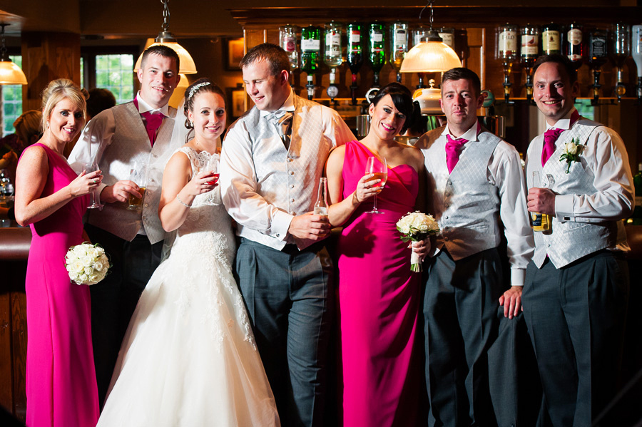 Group photo of the bride, groom, ushers and bridesmaids at a wedding at Grosvenor Pulford