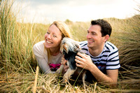 A couple and their Yorkshire Terrier enjoying a portrait shoot on Talacre Beach by Celynnen Photography for their pre wedding session