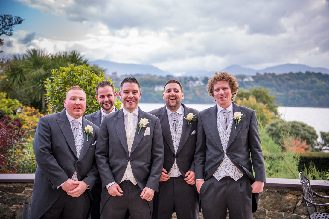 Photo of the groom with his ushers at a wedding at Chateau Rhianfa.