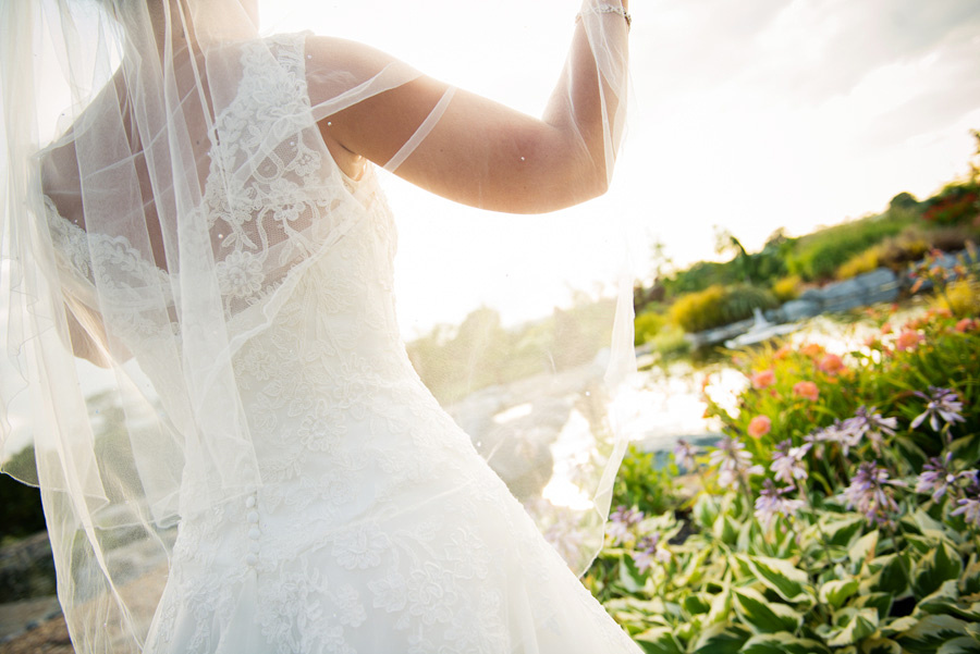 Image of the back of the bride at a wedding at Grosvenor Pulford