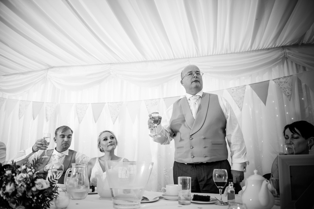 Black and white image of the father of the bride giving a toast at a wedding at Pentre Mawr.