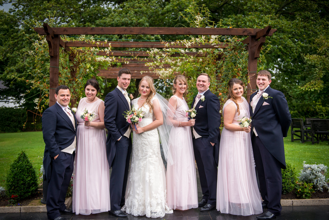 Outdoor portrait of the bridal party from wedding at The Kinmel.