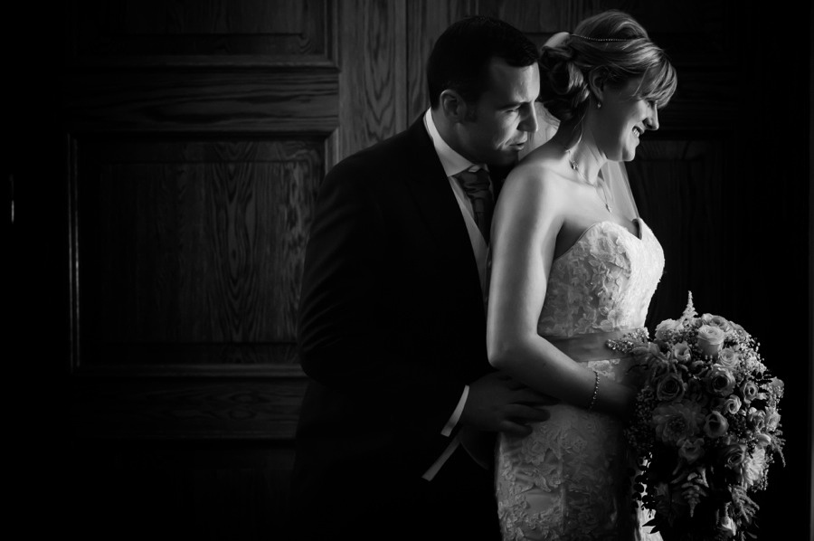 Groom holding Bride by North Wales Wedding Photographer Celynnen Photography