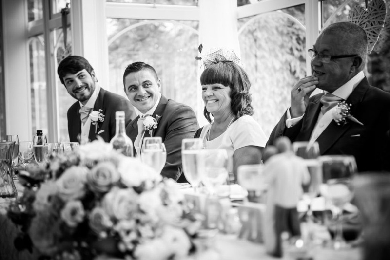 Black and white image of the guests during the speeches at a wedding at The Lion Quays.