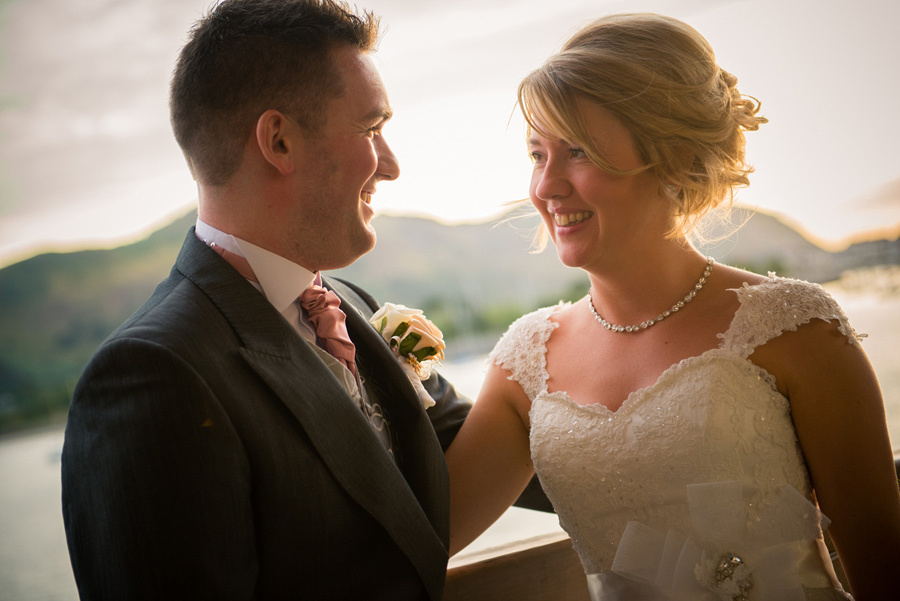 Bride and groom in the sunset at the Deganwy Quay. Wedding Photographer: Celynnen Photography