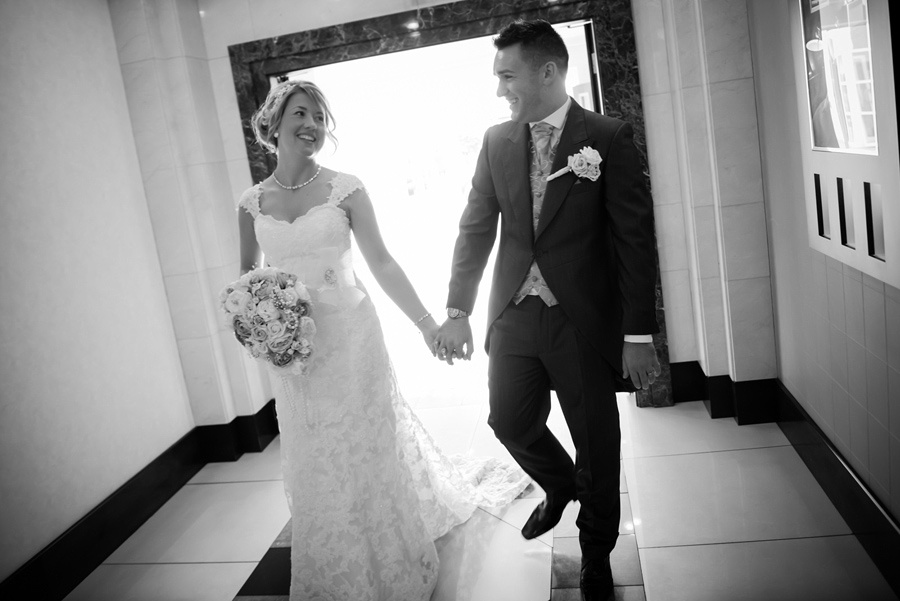 bride and groom at the Deganwy Quay. Wedding Photographer: Celynnen Photography